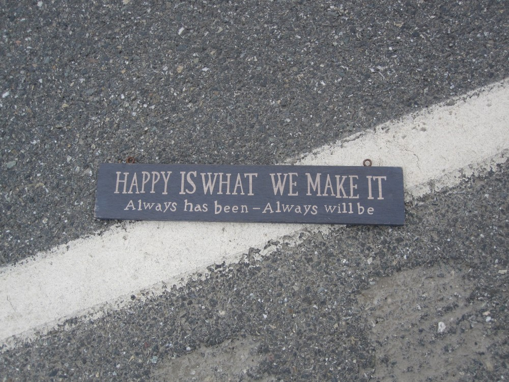 Happy is what we make it sign