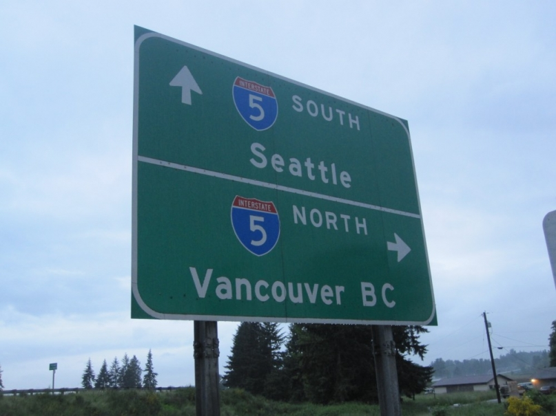 Seattle to Vancouver sign