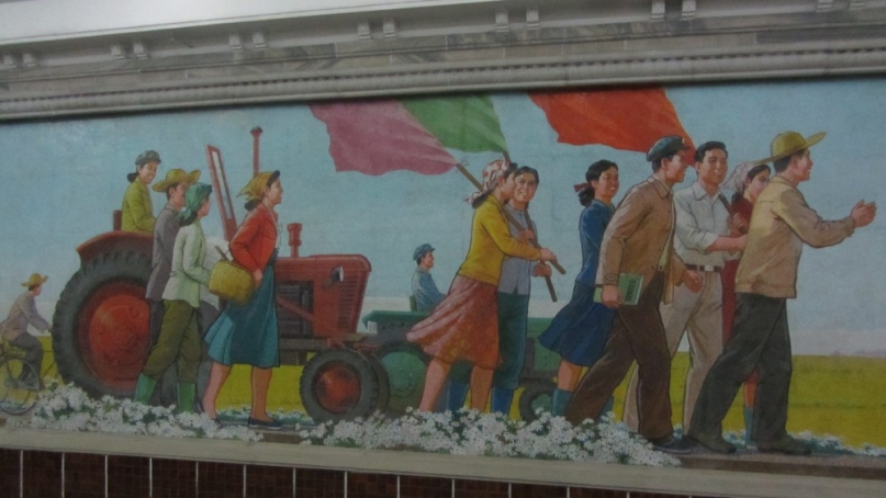A wall mosaic in the Pyongyang underground metro