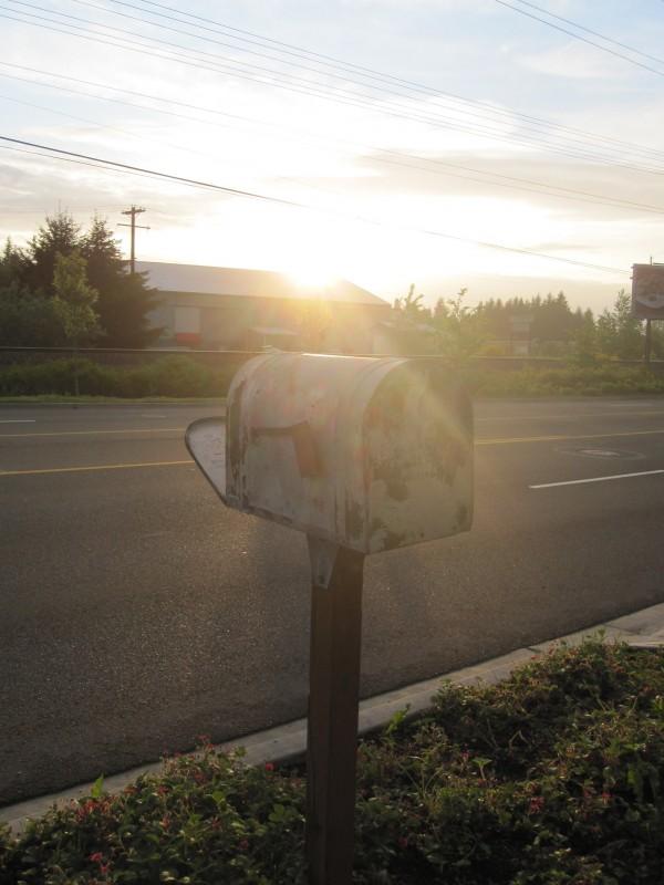 Letterbox outside abandoned house