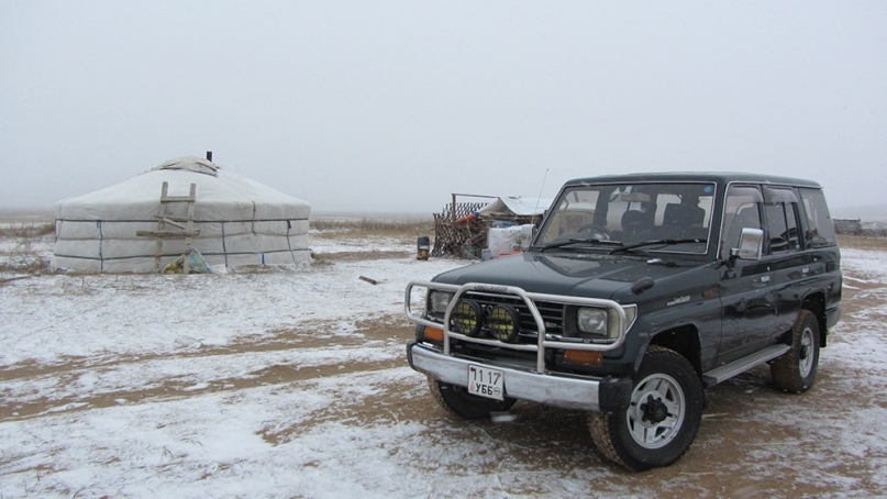 Jeep and Ger in Mongolian desert