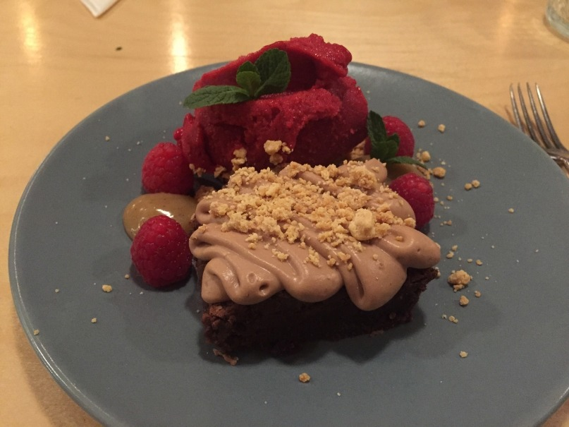 Selma's homemade raspberry sorbet and chocolate fudge brownie with caramel sauce.
